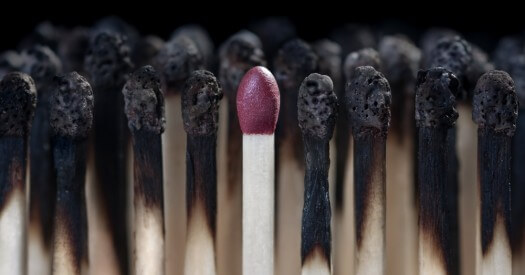 Burnt matches and one unburnt